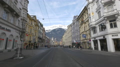 View of mountains and people walking on Maria-Theresien-Strasse, Innsbruck Stock Footage