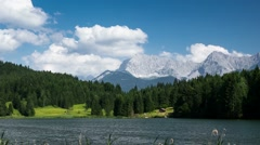 Wagenbruchsee with alp mountains in Germany time-lapse - stock footage