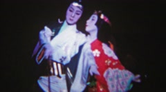 1956: Japanese opera show white face geisha man calm serene. - stock footage