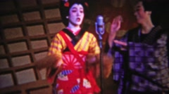 1956: Japanese comedy show funny geisha man dancing silly. Stock Footage