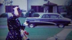 1954: Women blue potka dot dress fancy new classic car parked. Stock Footage