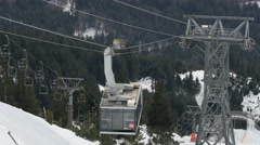 View of a cable car and chairlifts running at a ski resort in Innsbruck Stock Footage