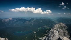 View from the Zugspitze peak on Garmisch-Partenkirchen and Eibsee time-lapse Stock Footage