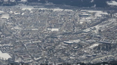 Pan view of Innsbruck during the winter season Stock Footage