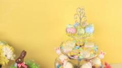 Dessert table set with cake and cupcakes for Easter brunch. Stock Footage