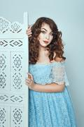 Stock Photo of Chubby brunette in a dress.