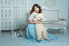 Plump woman hugging a bear. - stock photo