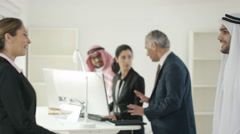 4K Portrait of smiling Western & Arab business people meeting & shaking hands Stock Footage