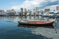 MALDONADO, FEBRUARY, 29, 2016 - Classic Red Fishing Boats moored in front of Stock Photos