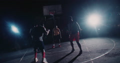 Basketball Players Playing in Court During Nighttime - stock footage