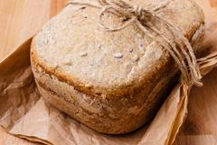 loaf of bread on backing paper - stock photo