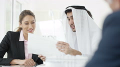4K Smiling Western & Arab business people shake hands in meeting Stock Footage