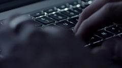 Typing on Illuminated Laptop Keyboard in Dark Room CU Stock Footage