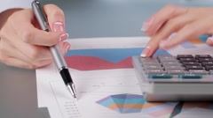 Experienced accountant conducts calculation. Stock Footage