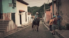 People riding horse in old town Stock Footage