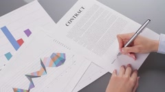 Woman signing rent contract. Stock Footage
