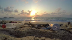Environmental Pollution. Garbage on Beach at Sunrise. UHD Stock Footage