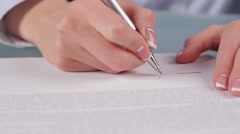 Stock Video Footage of Woman signing  contract.