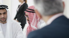 4K Arab businessmen with laptop negotiating in a meeting Stock Footage
