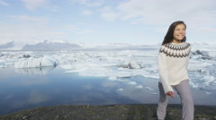 Girl walking outdoors in Iceland nature landscape visiting tourist destination Stock Footage