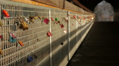 Beautiful view of colorful love locks on Hans Psenner bridge, Innsbruck - stock footage