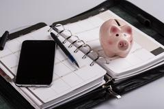 Plan your future and business - calendar, planner, cellphone, pen and pig mon Stock Photos