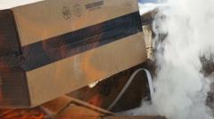 Burning cardboard boxes-flames smoke - stock footage