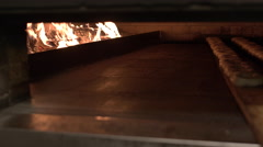 Bagels Being Cooked in Wood Fire Oven. - stock footage