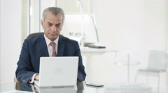 4K Portrait smiling Arab businessman working on laptop in office Stock Footage