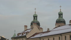 Flock of birds flying above the bell towers of Saint Jacob Cathedral, Innsbruck - stock footage