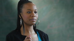 Black female teacher teaching in a classroom - stock footage