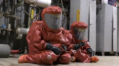Firefighters dressing protective suit waiting for sealing a leaking container  Stock Footage