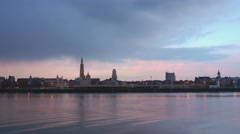 antwerp skyline at sunset as seen from river - stock footage
