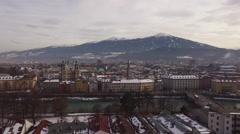 Aerial shot of Karwendel Alps, Inn river and buildings in Innsbruck Stock Footage