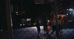 Basketball Players Playing in Court During Nighttime Stock Footage