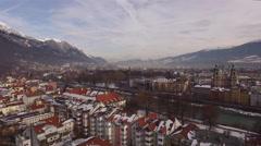 Aerial view of Karwendel Alps, Inn River and buildings in Innsbruck Stock Footage