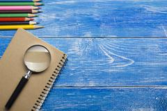 Top View of Creative Writing Concept With Pencils, Book, Notepad on Wooden Table Stock Photos