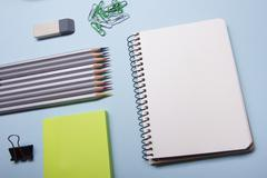 Office desk table with supplies top view. Notepad, pen and colorful paper. Copy Stock Photos