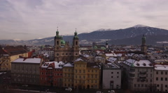 Aerial view of cars driving close to Saint Jacob Cathedral, Innsbruck Stock Footage