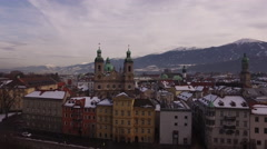 Aerial view of cars driving by Inn River and old buildings, Innsbruck Stock Footage