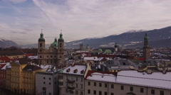 Aerial view of cars driving on a street and Saint Jacob Cathedral, Innsbruck - stock footage