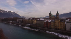 Aerial view of Saint Jacob Cathedral close to Inn River in Innsbruck - stock footage