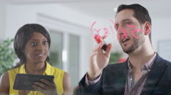 4K Business man & woman brainstorming for ideas, writing math formula on screen - stock footage