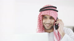 4K Smiling Arab businessmen working together on computer - stock footage
