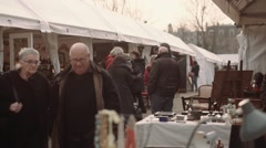 Vendors talking at flea market Stock Footage