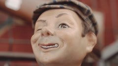 Creepy automaton toy at antique fair - clockwork Stock Footage