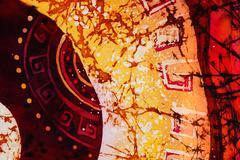 Ornament, hot batik, background orange and red texture, handmade on silk - stock illustration