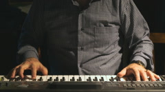 Man playing the synthesizer at the club Stock Footage