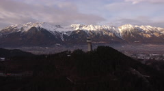 Beautiful view of Karwendel Alps and Bergiselschanze in Innsbruck, aerial shot Stock Footage