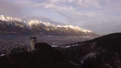 Aerial view of Karwendel Alps and Bergiselschanze in Innsbruck Stock Footage